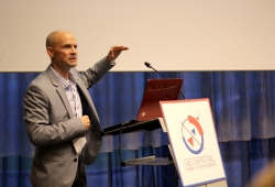 Photo of a speaker during a conference
